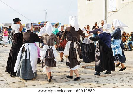 Amateurs In Native Dresses Dancing Folk Dance