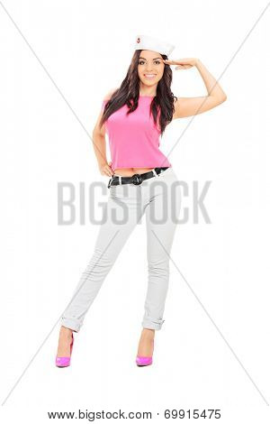 Full length portrait of a beautiful woman with sailor hat making a greeting sign isolated on white background