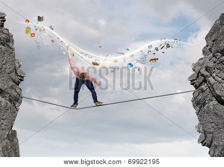 Young man in casual evading from flying icons