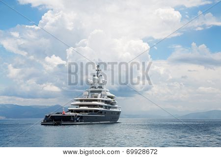 Gigantic Big And Large Luxury Mega Yacht With Helicopter Landing Place On The Blue Ocean.