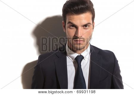 closeup of a young fashion business man's face  against white studio background