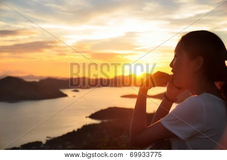 Side portrait of girl making phonecall when sunset