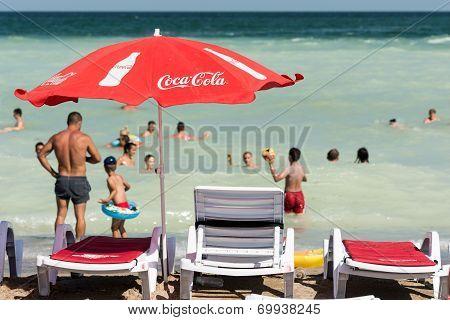 Coca Cola Umbrella On Beach