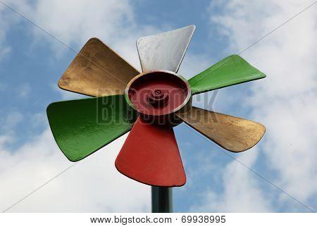 Colorful pinwheel windsock and sky