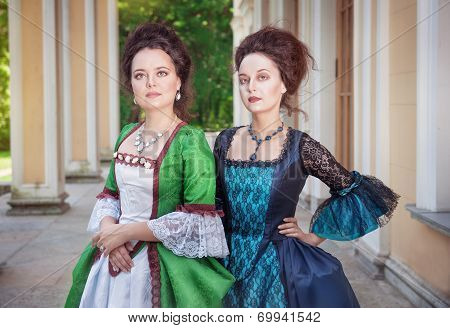 Two Beautiful Women In Medieval Dresses