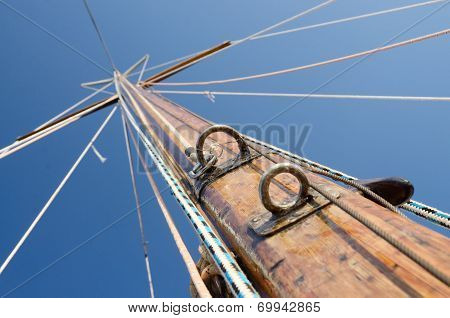 Old Wooden Mast With Crosspieces And Backstays, View From Deck Of Boat