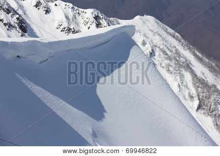 winter mountain slope and snow cornice