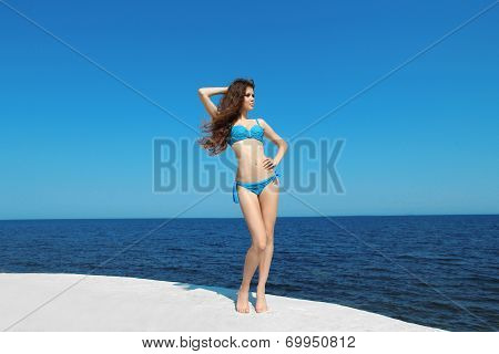 Beautiful Slim Bikini Model Girl Over Blue Sky. Fit Life. Enjoyment. Fashion Woman Relaxed. Good Lif