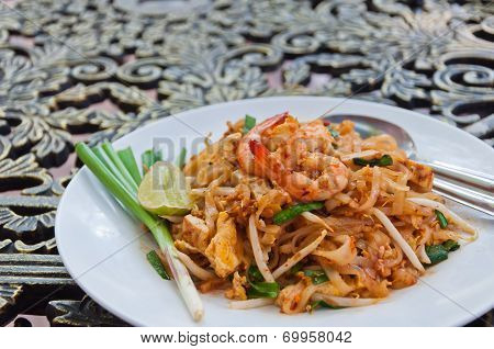 A Plate Of Fried Noodle With Shrimp In Thai Style