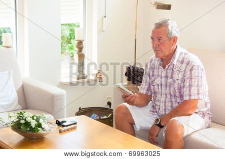 Senior Man Zapping Remote Control