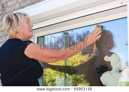 Woman Washing Small Window Close Up