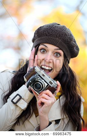 Surprised Woman Taking Photos In Autumn