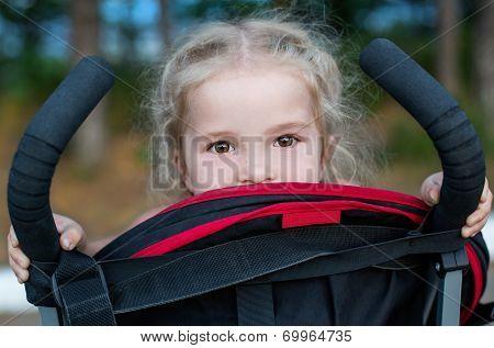 Happy Little Girl In A Stroller