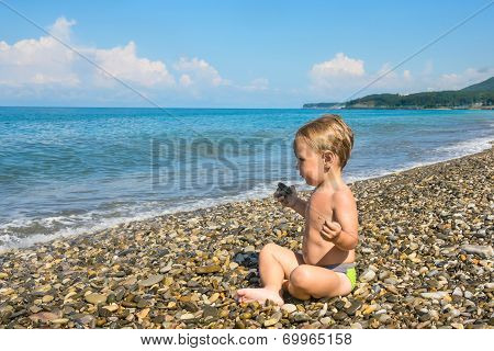 Baby Boy In Lotus Pose On Beach