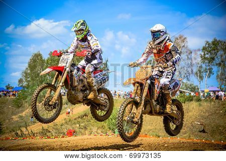 Motocross Riders On The Race