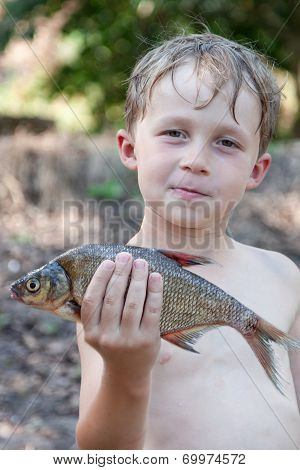 Young Fisherman Caught A Bream