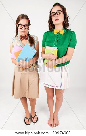 Cute Nerdy Girls Holding Books.