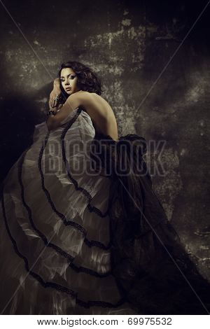Women Beauty Fashion Dress, Girl In Draped Gown Over Artistic Grunge Dark Background