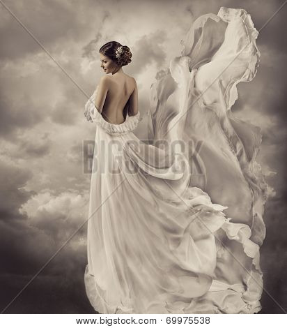 women portrait in retro dress, artistic white blowing gown, waving and fluttering fabric, fantasy we