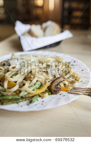 delicious italian meal of linguini with vegetables
