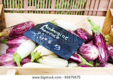 Fresh Eggplants, Aubergine Vegetables On Street Market In Provence, France.