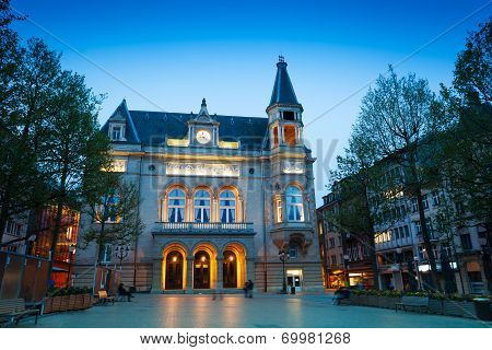 Cercle Municipal with lights at night time