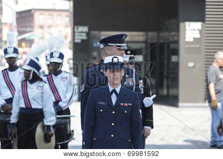 Honor guard alongside marching band