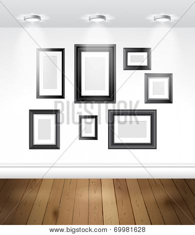 Gallery interior with empty frames on the wall