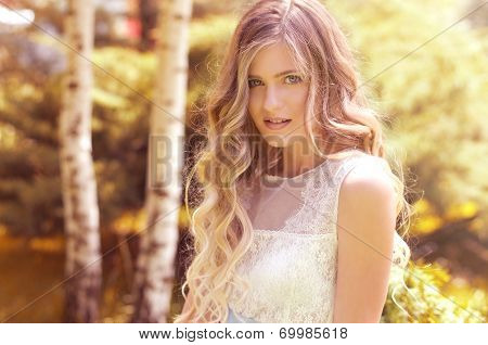 Beautiful young girl on summer garden