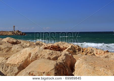 Sea Wall with Small lighthouse on the Mediterranean Sea in Herzliya Israel