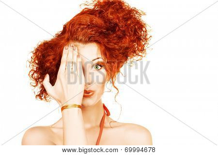 Cheerful young woman with beautiful red curly hair. Isolated over white.