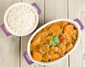 stock photo of stew  - Lamb and sweet potato peanut stew served with white rice - JPG
