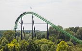 stock photo of amusement park rides  - Rollercoaster ride in an amusement park in the Netherlands - JPG