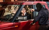 stock photo of mobsters  - Robbery of the businessman in its car - JPG