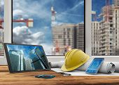 picture of blueprints  - tablet smartphone safety helmet and blueprints in construction site - JPG