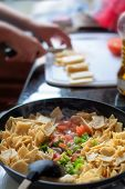 stock photo of mexican  - Preparing and cooking Chilaquiles, a traditional Mexican dish.