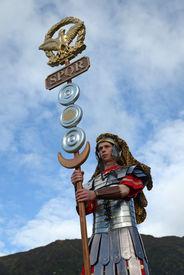 stock photo of spqr  - An unidentified actor dressed as a Roman standard bearer inspires the men for battle  - JPG