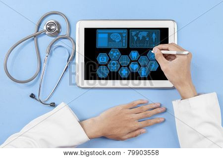 General Doctor Hands Using Tablet