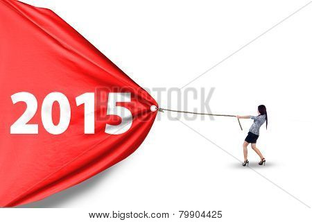 Hispanic Woman Dragging Number 2015 In Studio