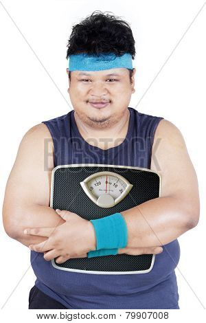 Overweight Person Holding Weight Scale
