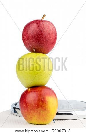 several apples on a balance of people. photo icon for diet and healthy, vitamin-rich diet.