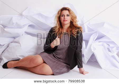 Fashionable, elegant woman with voluptuous curves in a dress.