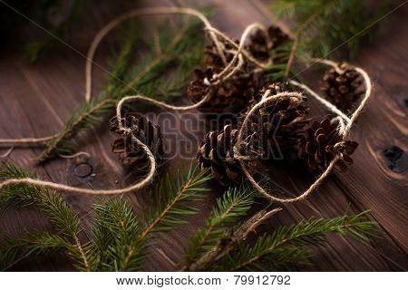Holiday Decoration Spruce With Cones On Wooden Background