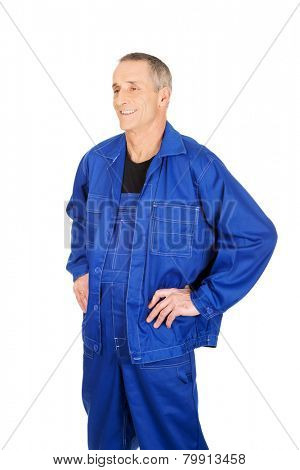 Smiling repairman with hands on hips.