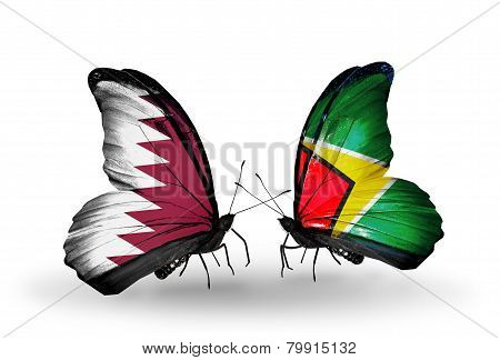 Two Butterflies With Flags On Wings As Symbol Of Relations Qatar And Guyana