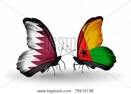 Two Butterflies With Flags On Wings As Symbol Of Relations Qatar And Guinea Bissau