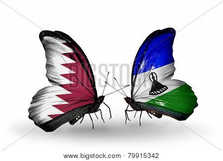 Two Butterflies With Flags On Wings As Symbol Of Relations Qatar And Lesotho