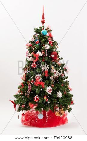 Decorated Christmas Tree In A Red And White Theme
