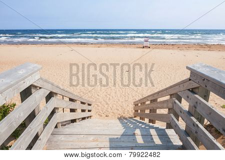 Wooden steps leading to Atlantic beach in Prince Edward Island, Canada