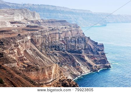 Cliff and volcanic rocks of Santorini island, Greece. Caldera and Aegean sea